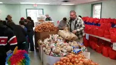 Volunteers have been at Wills Park since 8 AM preparing Thanksgiving baskets.   Distribution begins at 2:00 PM