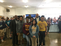 Warren with students at Howard High School