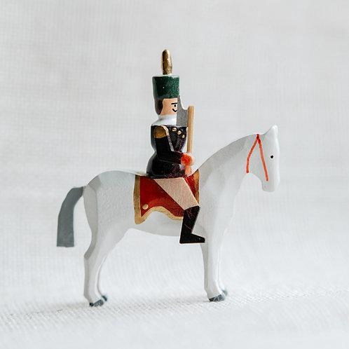 Berghauptmann auf weißem Pferd