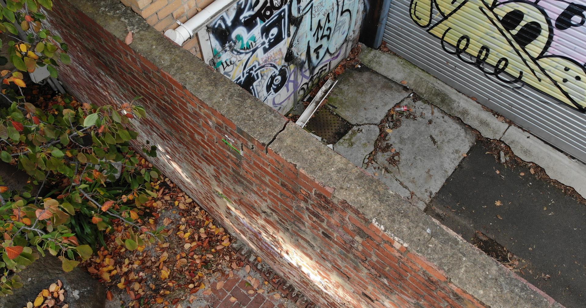 Distressed free standing brick wall.