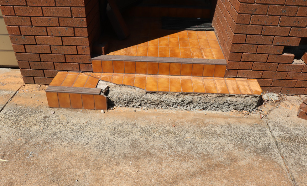 Honeycombing of concrete steps.