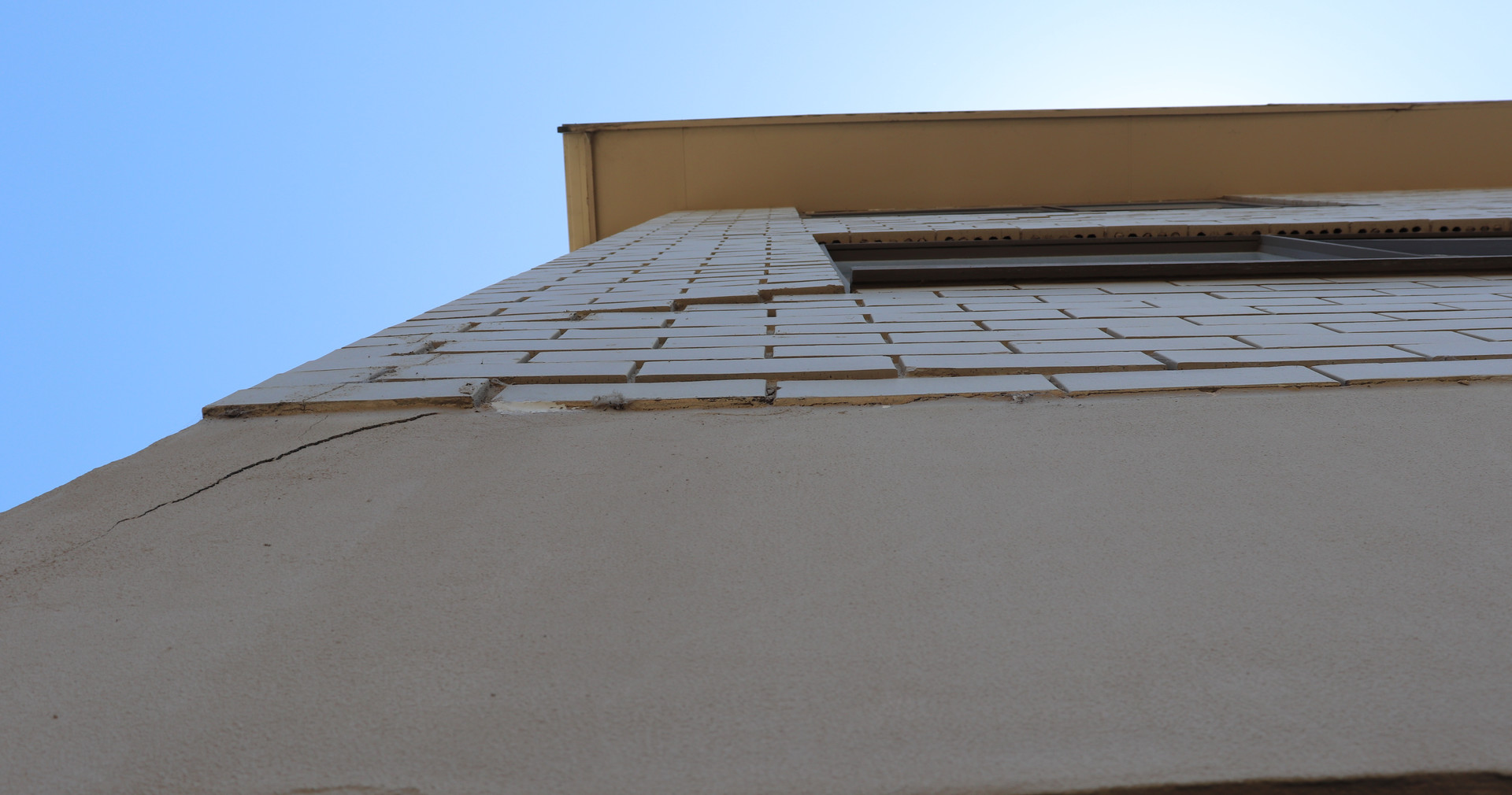 Apartment brick wall shifting.