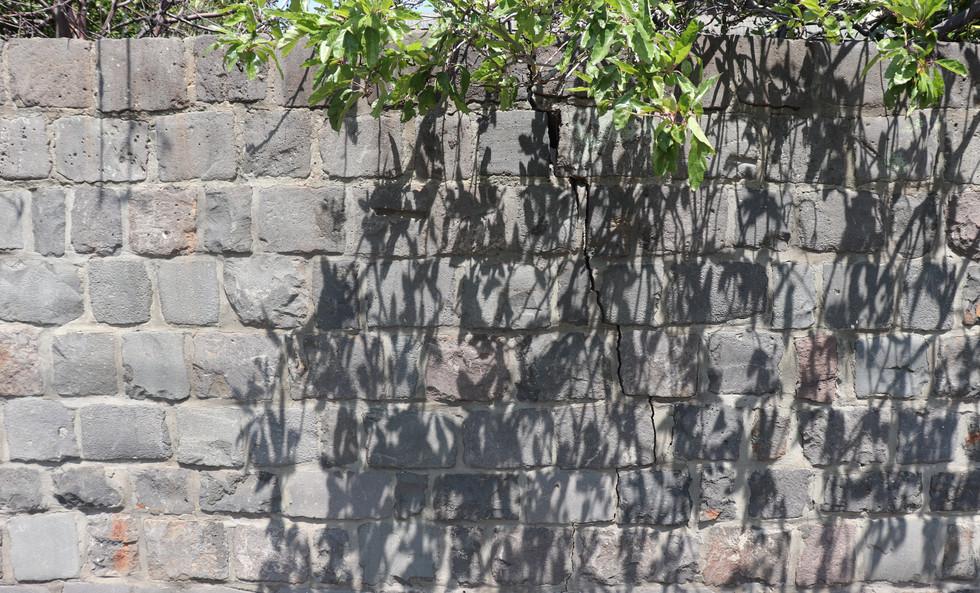 Cracked bluestone wall.