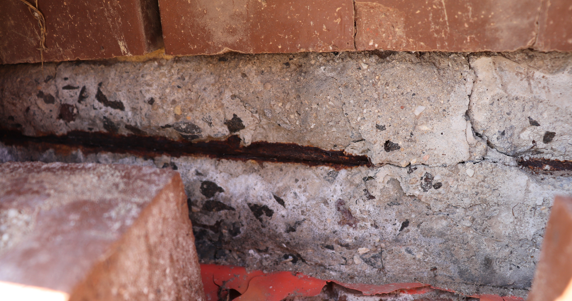 Exposed slab reinforcement corrosion.