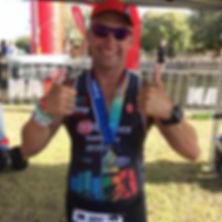 Triathlon coach Brad Martens racing in Woolongong
