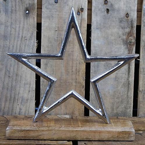 Aluminium Star on Wood
