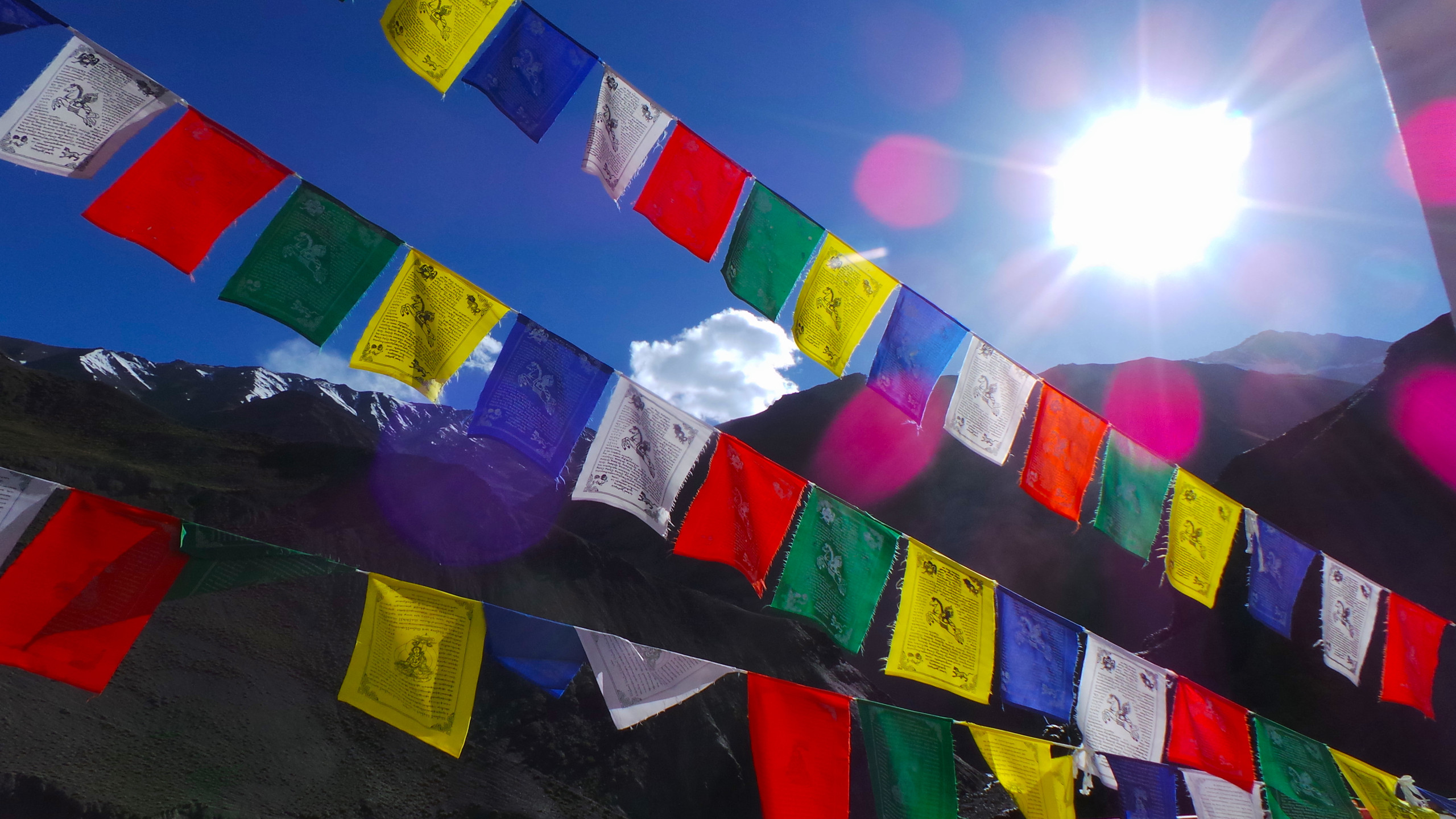 Tibetan prayer flags blowing in the breeze that carries their blessings to all it touches.