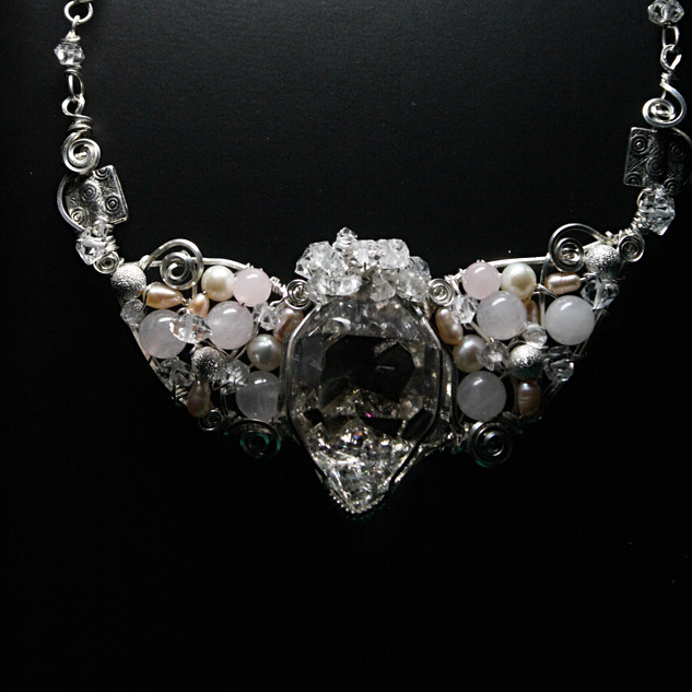 A very large Natural Herkimer Diamond in the center, surrounded by Rose Quartz and Pearls.