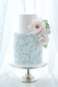 Pink and blue cake with lace