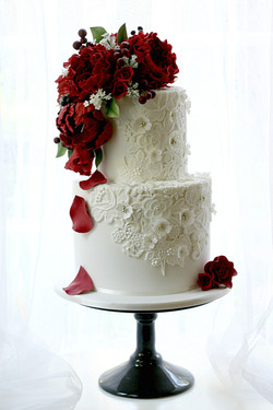 Red floral wedding cake with lace