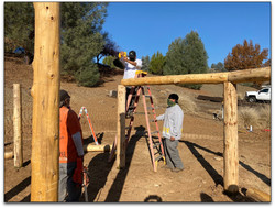 Making sure each and every support beam is level and bound securely.