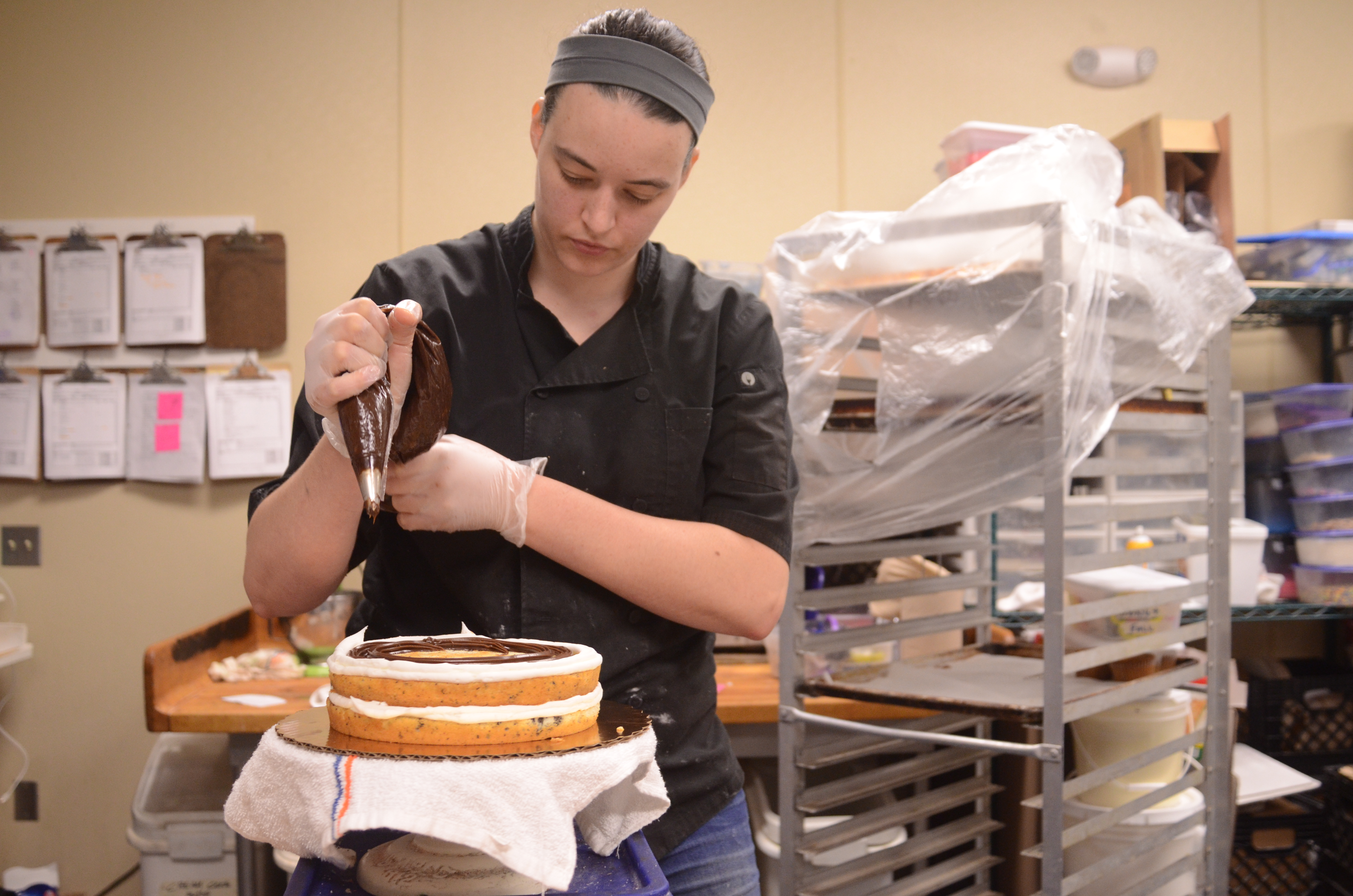 Haley Chapman begins icing the cake