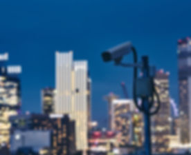 security-camera-against-urban-skyline-2P