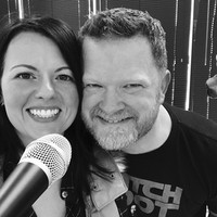 Amy and her husband leading worship