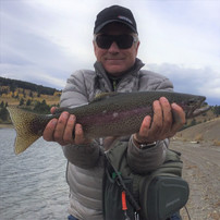 Steve with a healthy trout from the Land of Giants, Montana