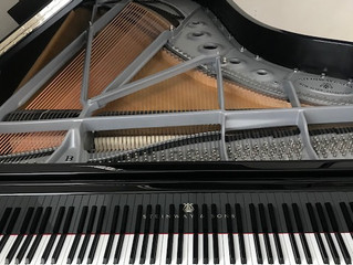 Piano tuning service and action regulation on Steinway