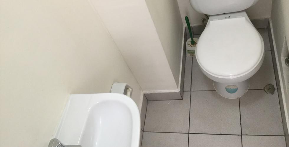 Baño de servicio