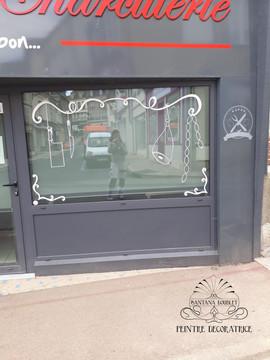 Décor pour la vitrine d'une boucherie charcuterie