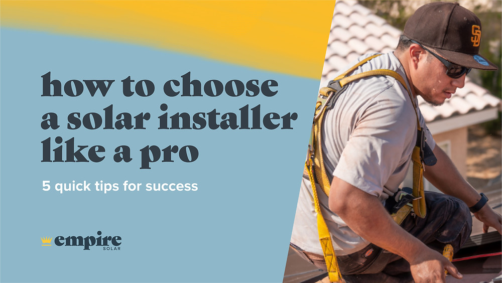 """Empire Solar Group banner image with text reads, """"How to choose a solar installer like a pro, 5 quick tips for success"""" with a yellow and blue background and features a man wearing a San Francisco Giants Hat wearing a harness installing a solar panel on roof."""