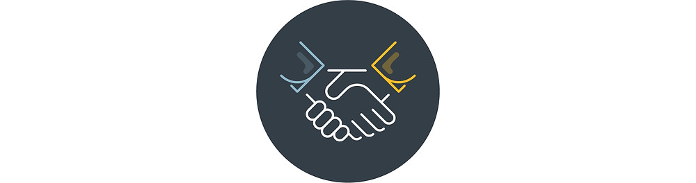 Two hands grasp each  other in a handshake.