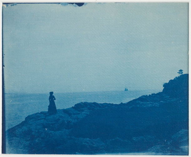 """Woman_Watching_Schooner_from_a_Rocky_Promontory""_(late_19th–early_20th).jpg"
