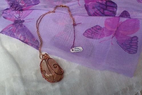 Rose Quartz pendant wrapped in Copper