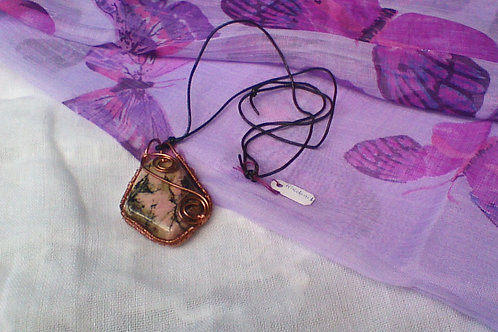 Rhodonite pendant wrapped in copper