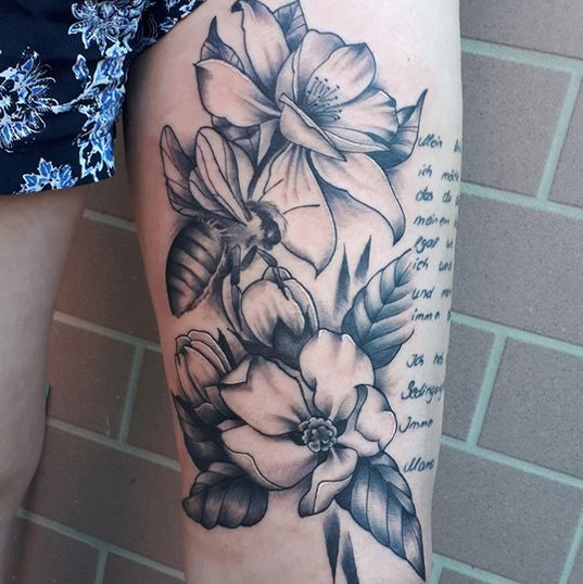 fineline flower tattoo.jpg