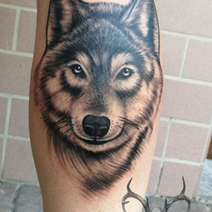 wolf tattoo black and grey.jpg