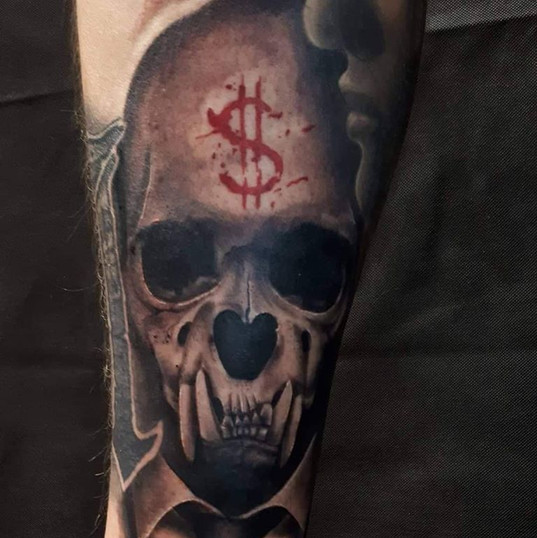 abnorm skull tattoo.jpg