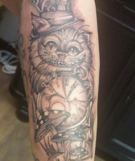 Alice in wonderland tattoo.jpg