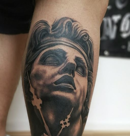 statue tattoo.jpg