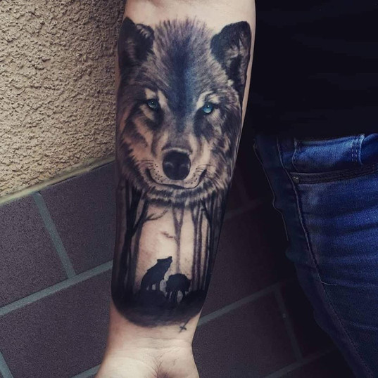 wolf forest tattoo.jpg