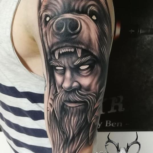 Old men bear tattoo.jpg