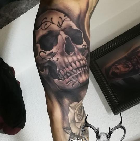 realistic skull tattoo.jpg