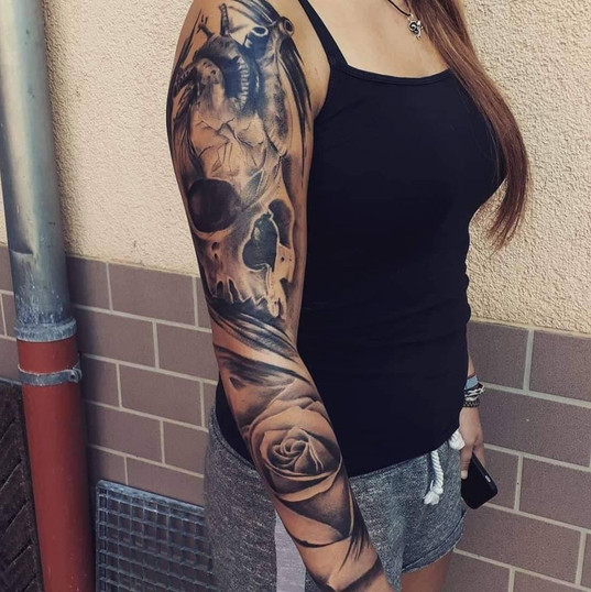 skull roses sleeve tattoo.jpg