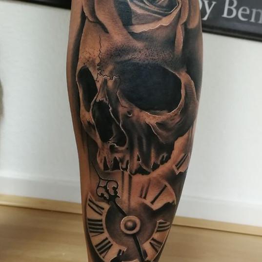 skull roses tattoo.jpg