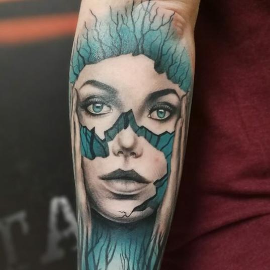 broken face tattoo.jpg