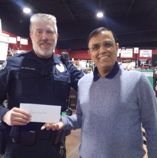 Nick Patel, owner of Happy Hour liquor store making a donation to the CHF.