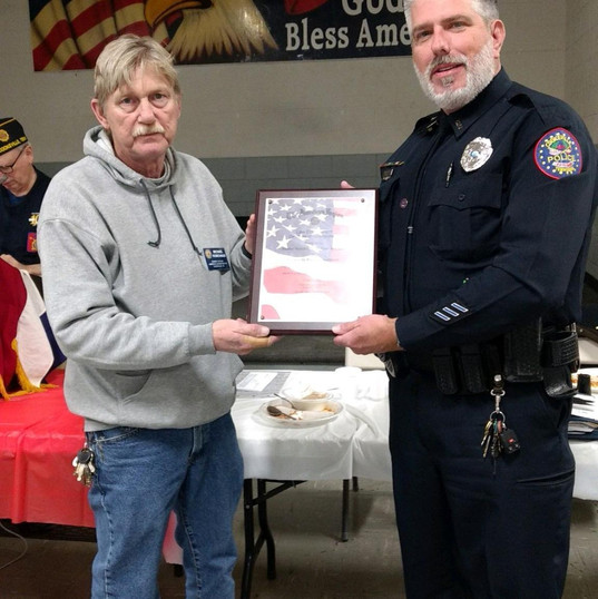 Officer deClaire receiving Officer of the Year from the American Legion Cookeville, TN Post #46