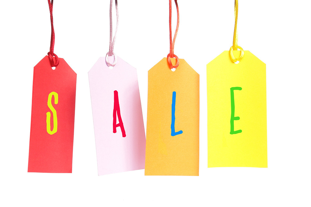 the word sale on several hanging price tags