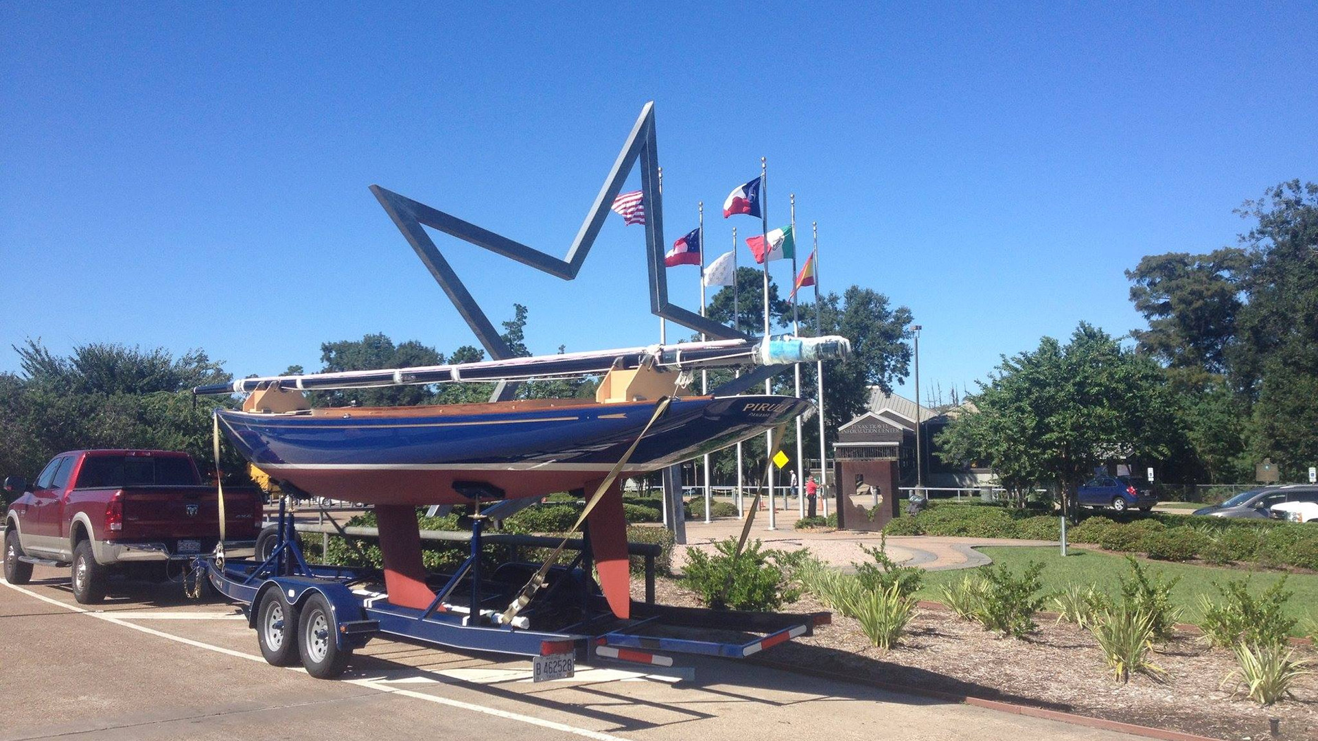 Hood 32 on trailer in Texas en route to Panama with mast and cradle in place.