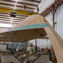The team buillt a custom cradle to accommodate the hull bottom during resin-infusion.