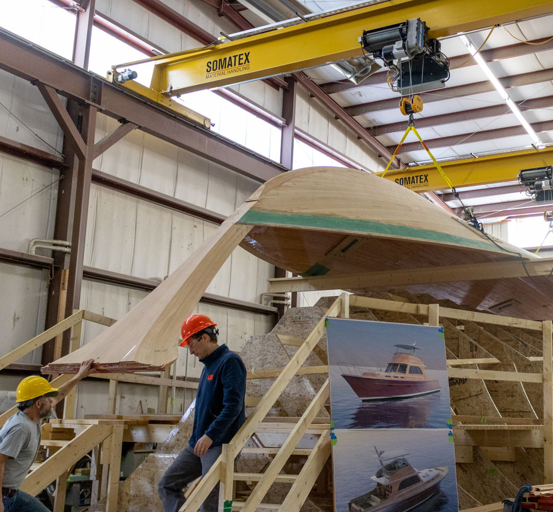 With the hull bottom planked and stem installed, the piece is lifted from the jig.