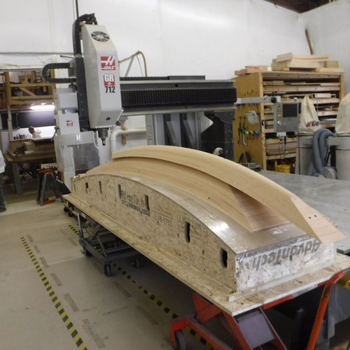 As the jig is erected, the CNC division cuts the stem pieces.