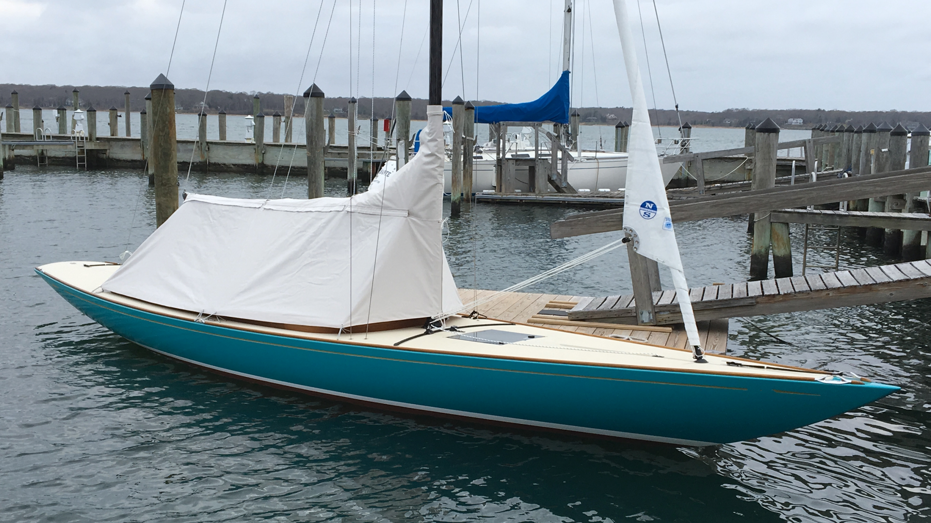 "Sunbrella ""natural"" cover with Island Turquoise Awlgrip hull"