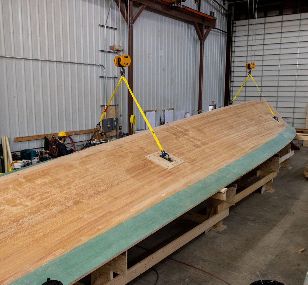 After the hull bottom is removed from the jig, it is prepared for flipping.