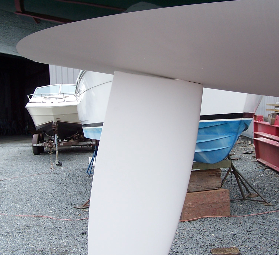 Optional carbon fiber elliptical rudder. this is standard when ordering acarbon mast and can be ordered separately.