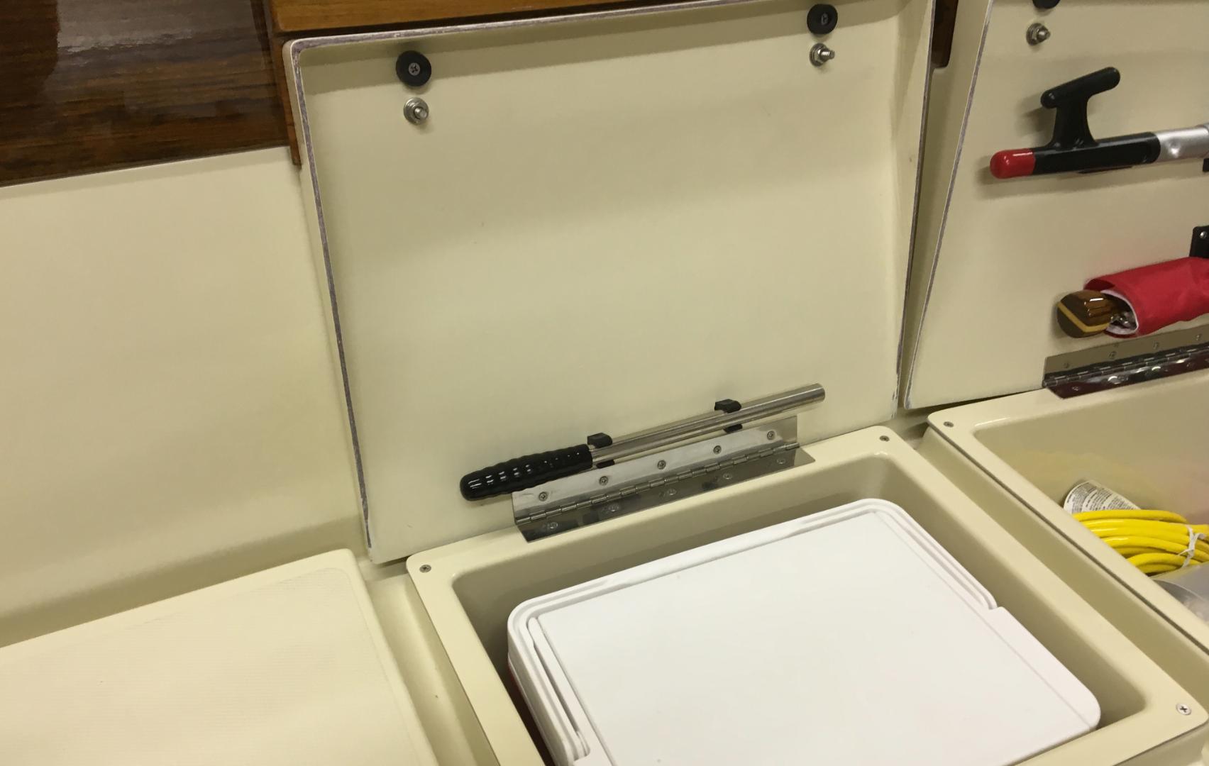 Port cooler locker. (2) coolers standard, both port and starboard.