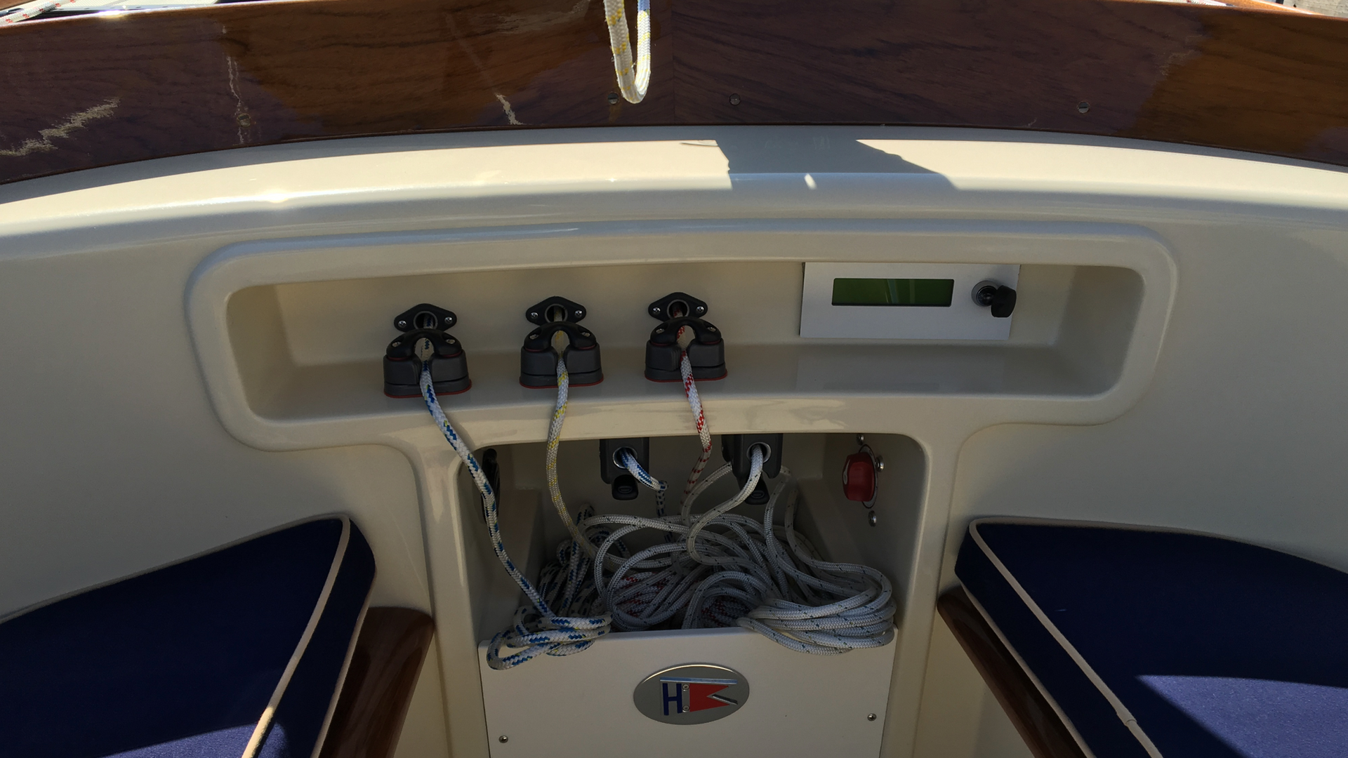 Forward console shows lower jib and main clutches - Above showing roller furler cleat (port), followed by optional asymmetrical package cleats, tack line and halyard respectively.